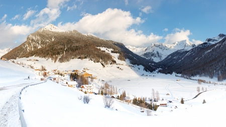 The idyllic village of Rein in Taufers in the Alps, South Tyrol, Italy, on a sunny winter day  photo