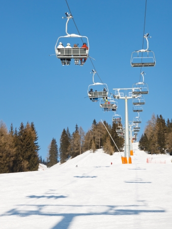 Charilift at ski resort transporting skiers to the summit. photo