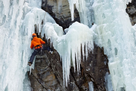 ice axe: Ice climber on his way up on a frozen waterfall in South Tyrol, Italy  Stock Photo