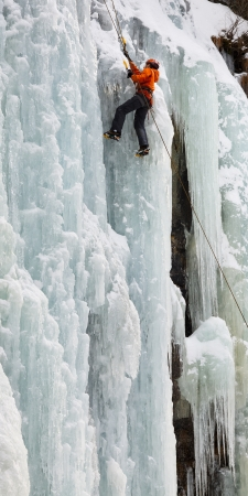 dolomites: Ice climbing on a frozen waterfall in South Tyrol, Italy. Stock Photo