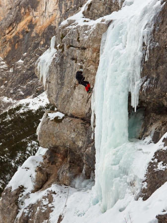 rappelling: Ice climber rappelling down frozen waterfall in South Tyrol, Italy. Stock Photo