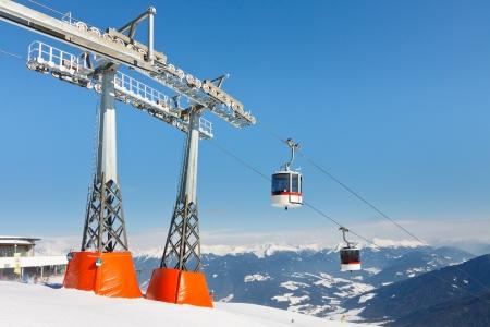 station ski: Gondolas reaching the summit station of alpine ski resort in South Tyrol. Stock Photo