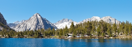 High Sierra Alpine Lake Panorama. East Vidette towering above Bullfrog Lake. California, USA.