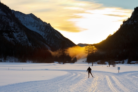 crosscountry: Cross-country skiing at sunset in the Alps, South-Tyrol, Italy.