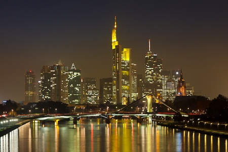 Frankfurt Financial District at Night Reflecting in the Main River. photo