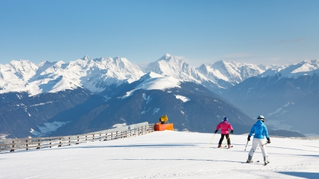 Skiers enjoy a sunny day on the mountains in South Tyrol. photo