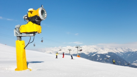 Snow cannon used to make artificial snow at ski resort in the Alps. photo