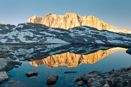 john muir wilderness: Sierra Nevada Alpenglow Reflection - Mount Hitchcock mirrors in a lake at sunrise.