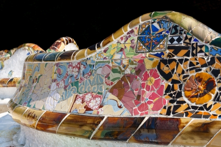 architectural heritage of the world: Mosaic work by Antoni Gaudí at Park Güell in Barcelona, Spain. Part of the UNESCO World Heritage Site Works of Antoni Gaudí. Isolated on black.