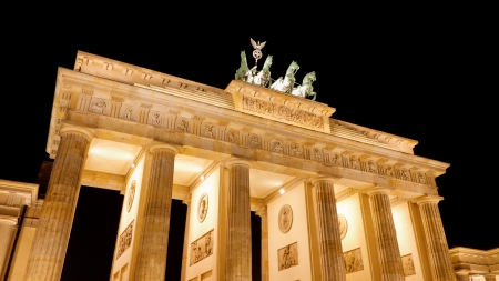 historic world event: The Brandenburger Tor (Brandenburg Gate), the main landmark of Berlin, Germany, Europe, at night Editorial