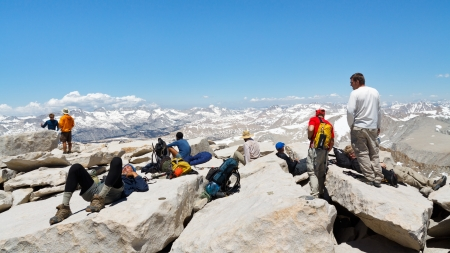 continental united states: MOUNT WHITNEY, CA - JUNE 30: Hikers rest after a strenuous climb on June 30, 2010, on the summit of Mount Whitney. In 2009 ca. 25,000 people summited the highest peak in the continental United States.