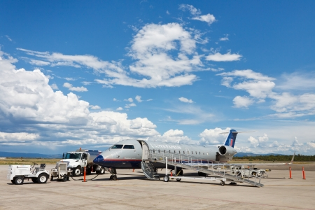 bombardier: DURANGO, CO - AUGUST 3: Bombardier CRJ200 on August 3, 2011, at Durango-La Plata County Airport, CO. Due to its narrowness many airlines are in the process of transitioning to the larger CRJ700 model.