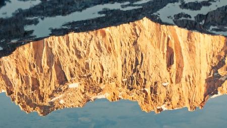 john muir trail: Golden Mountain Reflection - Sierra Nevada peak mirrors in an alpine lake. Stock Photo