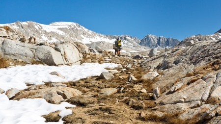 pct: Alpine Hiking - Hikers on their way to a high mountain pass in the Sierra Nevada, California, USA.