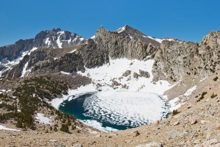 john muir trail: Frozen Alpine Lake in the Sierra Nevada Mountains, California, USA