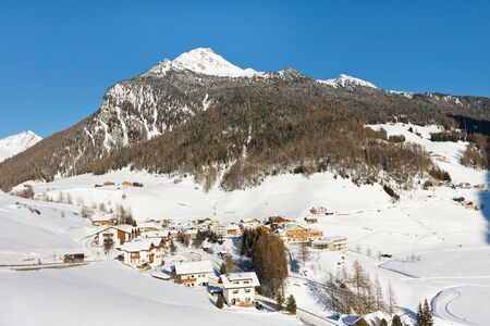 A sunny winter day at the idyllic alpine village of Rein in Taufers, South Tyrol, Italy. photo