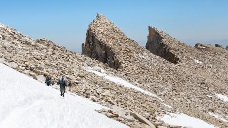 Hiking Mount Whitney. Hikers descending from Californias highest mountain peak. Stock Photo