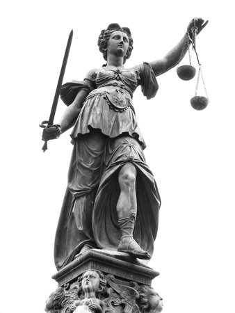 law scale: Statue of Lady Justice (Justitia) in Frankfurt, Germany. Isolated on white.