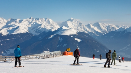 Skiers on a ski run in the Dolomites, South Tyrol, on a beautiful winter day. photo
