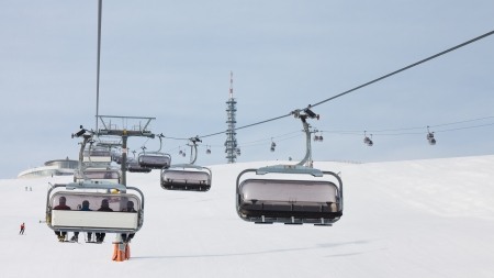 Skiers ride a chairlift in South Tyrol, Italy photo