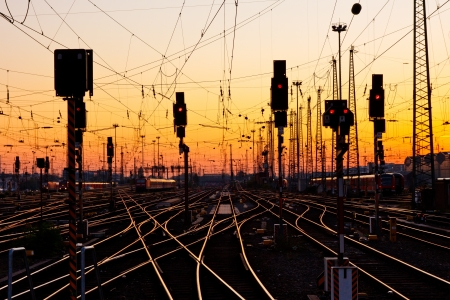 rails: Railway Tracks at a Major Train Station at Sunset. Stock Photo