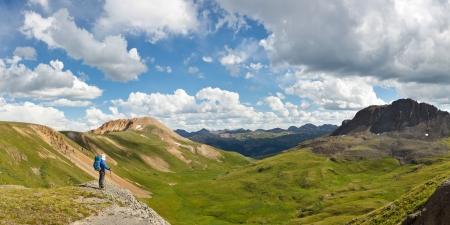 alpine tundra: Outdoor Adventure Panorama. Hiker enjoys grand view of alpine tundra in Colorado, USA.