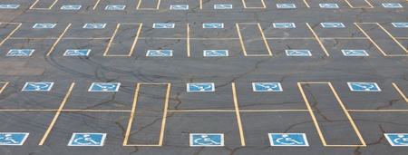 disabled parking sign: Parking spaces reserved for the disabled in outdoor parking lot. Stock Photo