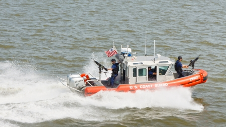 coastguard: NEW YORK - SEP 3: A U.S. Coast Guard boat on patrol on September 3, 2011 near Liberty Island, New York. As of August 2009 the Coast Guard had approximately 42,000 men and women on active duty.