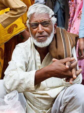 glases: RAWALPINDI, PAKISTAN - JULY 16: Unidentified Pakistani man at Raja Bazaar on July 16, 2011 in Rawalpindi, Pakistan. Raja Bazaar is the main shopping area & tourist attraction in Rawalpindi.
