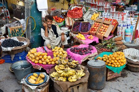 pakistani pakistan: RAWALPINDI, PAKISTAN - JULY 16: Unidentified Pakistani man sells fresh fruits at Raja Bazaar on July 16, 2011 in Rawalpindi, Pakistan. Raja Bazaar is the main tourist attraction in Rawalpindi. Editorial
