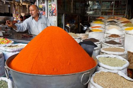 RAWALPINDI, PAKISTAN - JULY 16: Unidentified Pakistani man sells spices at Raja Bazaar on July 16, 2011 in Rawalpindi, Pakistan. Raja Bazaar is the main shopping area in Rawalpindi. Stock Photo - 18889107