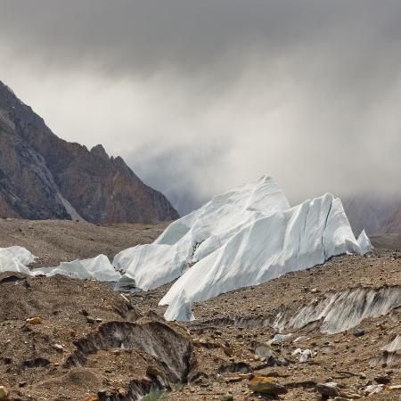 serac: Ice formations rising from the scree-covered Baltoro Glacier, Karakorum, Pakistan Stock Photo
