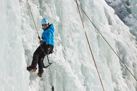 ice axe: A young woman climbs a frozen waterfall in South Tyrol, Italy  Stock Photo