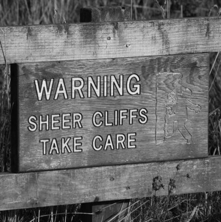 steep cliffs sign: Warning  Sheer Cliffs Take Care Stock Photo