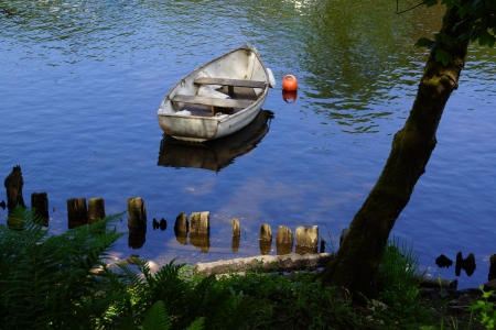 loch lomond: Small Boat Resting on Loch Lomond Stock Photo