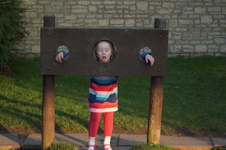 punished: A naughty child in stocks