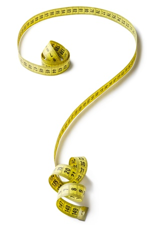 eating questions: Tape measure forming the shape of question mark Stock Photo