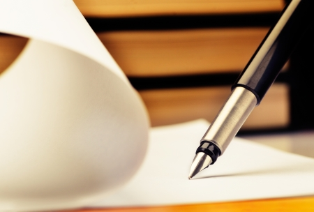 fountain pen writing: Close-up of fountain pen and book Stock Photo