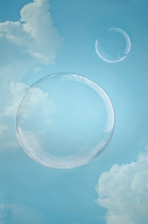 levitation: Day dreaming. Two floating soap bubbles against blue sky with copyspace