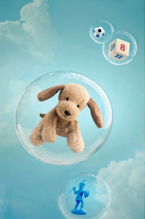 stuffed animals: Childhood dreaming. Toys floating in soap bubbles in the sky