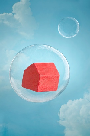 housing crisis: Housing crisis. Model house floating in a soap bubble in the sky