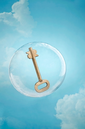 Cloud security. Key floating in a soap bubble in a cloudy sky
