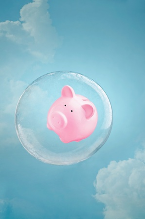 zero gravity: Secure savings. Piggy bank floating in a soap bubble in the sky