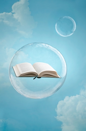 fantasy fiction: Magic of books. Open book floating in a soap bubble in the sky