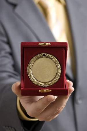 sports trophy: Golden medal offered as a symbol of success  Stock Photo