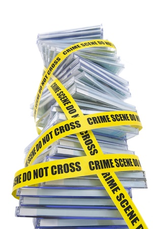 secure backup: A pile of pirated compact disks warped in police tape