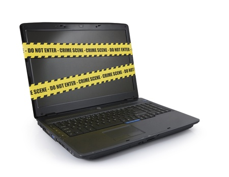 Laptop wrapped in police tape on a white background photo