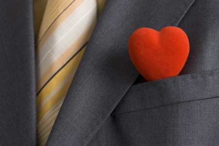truelove: A red heart in a suit pocket representing the business card of modern