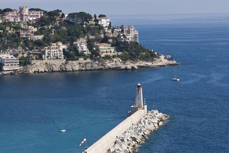 azur: The harbour and lighthouse in port of Nice, France