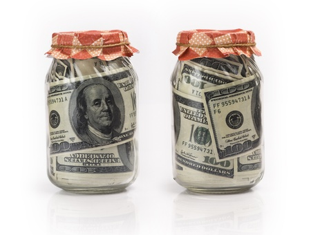 provisions: US dollar banknotes in jars on white background
